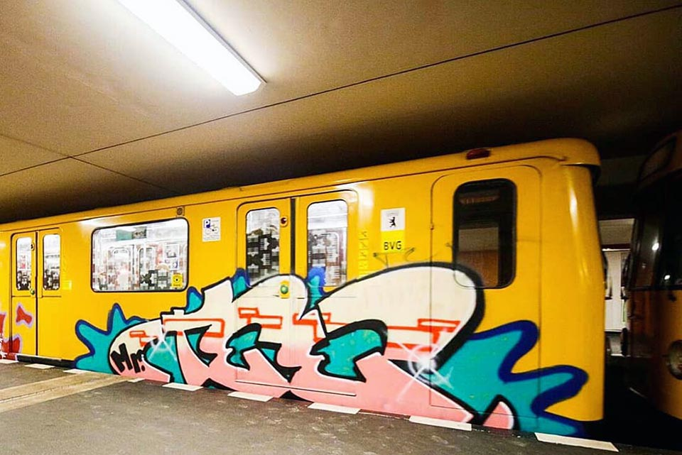 writing graffiti subway berlin germany mrtee